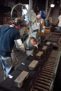 Metal melt pour sand cast