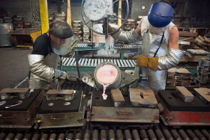 Foundry pouring molten metal sand casting